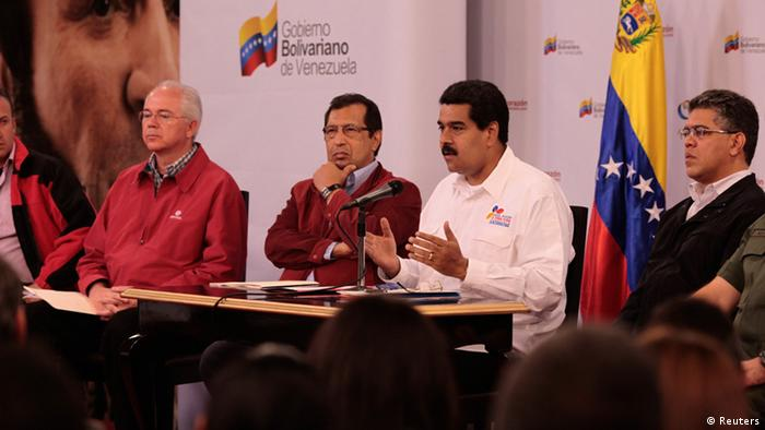Venezuela's Vice President Nicolas Maduro (2nd R) speaks during a meeting with political and military leader at Miraflores Palace in Caracas March 5, 2013 in this photo provided by Miraflores Palace. Venezuelan President Hugo Chavez was infected with cancer by imperialist enemies, his No. 2 alleged on Tuesday, adding that the socialist leader was suffering his hardest moments since an operation three months ago. Maduro's accusations and somber prognosis came during a televised meeting of political and military leaders at the presidential palace amid speculation of an imminent end to Chavez's 14-year rule. Pictured with Maduro are (L-R) Aragua's Governor Tareck El Aissami, Oil Minister Rafael Raemirez, Barinas' Governor Adan Chavez and Foreign Minister Elias Jaua. REUTERS/Miraflores Palace/Handout