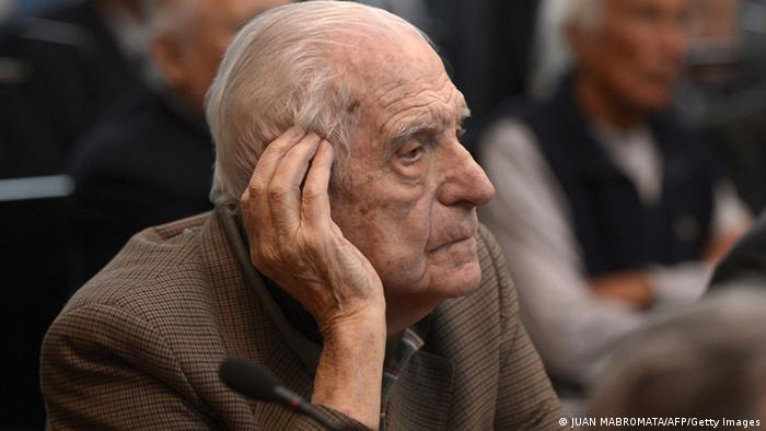 Former general and member of the military junta, Reynaldo Bignone gesture during his trial to investigate the crimes committed during the Operation Condor, a campaign established by Argentina, Chile, Paraguay, Brazil, Bolivia and Uruguay's dictatorships to quash the opposition during the 1970s, in Buenos Aires on March 5, 2013. Bignone served as de facto President (1982-1983) during the transition from military regime to democracy. The military junta that headed the regime is held responsible for the disappearance of up to 30,000 people during the so-called Dirty War against political opponents. Videla, Bignone and Menendez are among the 26 defendants. AFP PHOTO / Juan Mabromata (Photo credit should read JUAN MABROMATA/AFP/Getty Images)