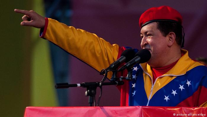 epa03260421 Venezuelan President Hugo Chavez delivers a speech before thousands of his followers after formalizing his candidacy for the presidential elections to be held on 07 October 2012, in Caracas, Venezuela, 11 June 2012. Wearing sports clothes with the colors of Venezuela, Chavez, 57, candidate for a third term, signed the certificate of registration at the National Electoral Council (CNE). EPA/MIGUEL GUTIERREZ