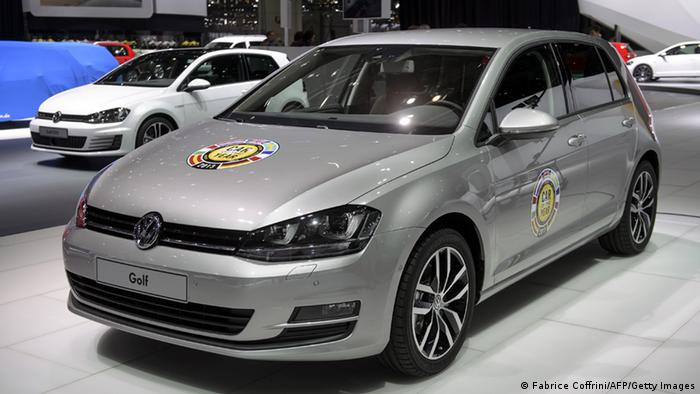 A VW Golf model car awarded 'Car of the year 2013' is seen on the German car maker's booth on March 4, 2013 on the eve of the press day of Geneva Motor Show in Geneva. The latest version of the Volkswagen Golf was elected Car of the Year Monday 2013 by 58 journalists from 22 European countries. AFP PHOTO / FABRICE COFFRINI (Photo credit should read FABRICE COFFRINI/AFP/Getty Images)