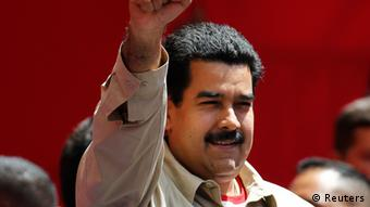 Venezuela's Vice President greets supporters during a rally in Caracas February 27, 2013. Venezuelans are commemorating the 24th anniversary of the social uprising known as 'Caracazo' which President Hugo Chavez said marked the start of the his revolution. Results from surveys showed that if Chavez is forced out due to cancer, his preferred successor Maduro is favored to win an election. REUTERS/Carlos Garcia Rawlins (VENEZUELA - Tags: POLITICS ANNIVERSARY)