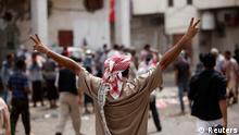 A supporter of the separatist Southern Movement gestures during clashes with security forces in the southern Yemeni port city of Aden February 21, 2013, ahead of planned rallies to mark the first anniversary of ex-president Ali Abdullah Saleh's ouster. Yemen has struggled to restore normality since President Abd-Rabbu Mansour Hadi was elected in February 2012 following a year of protests that forced his predecessor Saleh to step down after 33 years in power. REUTERS/Khaled Abdullah (YEMEN - Tags: POLITICS CIVIL UNREST ANNIVERSARY)