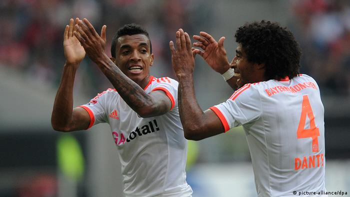 Dante and Luiz Gustavo celebrate Dante's goal for Bayern Munich against Fortuna Düsseldorf in the Bundesliga (20.10.2012) at Düsseldorf's Esprit-Arena. (Photo via Jonas Güttler, dpa)
