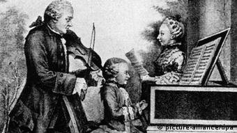 A picture of Mozart as a child playing the piano at a concert in 1763