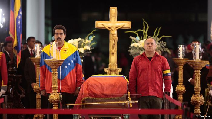Venezuela's Vice President Nicolas Maduro (L) and National Assembly President Diosdado Cabello stand guard next to the coffin of late Venezuelan President Hugo Chavez during a wake at the military academy in Caracas, March 6, 2013, in this picture provided by the Miraflores Palace. Authorities have not yet said where Chavez will be buried after his state funeral on Friday. REUTERS/Miraflores Palace/Handout (VENEZUELA - Tags: POLITICS OBITUARY) ATTENTION EDITORS - THIS IMAGE HAS BEEN SUPPLIED BY A THIRD PARTY. IT IS DISTRIBUTED, EXACTLY AS RECEIVED BY REUTERS, AS A SERVICE TO CLIENTS. FOR EDITORIAL USE ONLY. NOT FOR SALE FOR MARKETING OR ADVERTISING CAMPAIGNS