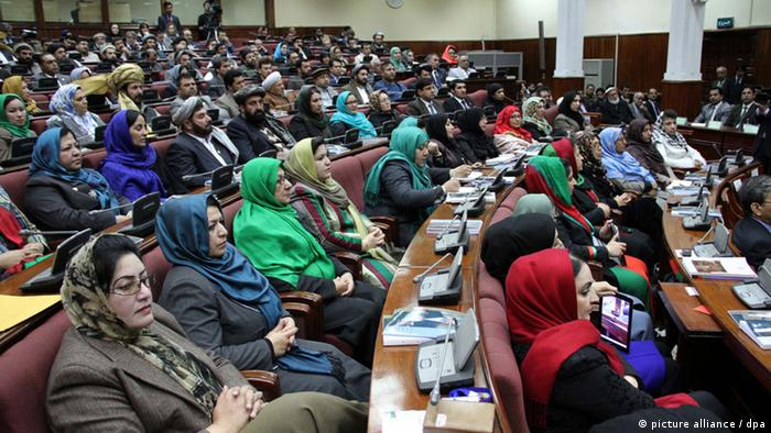 epa03611750 Afghan Parliamentarians listen to a speech by President Hamid Karzai (not in picture) during the opening session of Afghan Parliament in Kabul, Afghanistan, 06 March 2013. Karzai attended the opening session of the joint Afghan Parliament as it entered the third year of its constitutional five-year term. EPA/S. SABAWOON