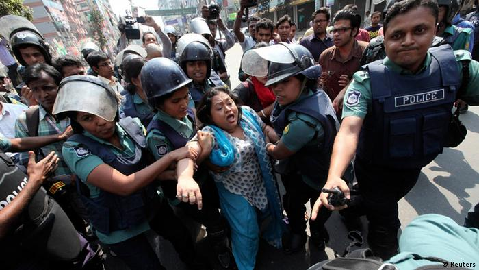 Shammi Akter (C) a lawmaker of the opposition Bangladesh Nationalist Party (BNP) is detained by police after falling off a police van during a country wide strike in Dhaka March 7, 2013. Bangladesh Nationalist Party and its alliance called the daylong strike in protest against what it said were violence and killings by the police in their protest rally over war tribunals on Wednesday, local media reported. REUTERS/Stringer (BANGLADESH - Tags: POLITICS CIVIL UNREST)