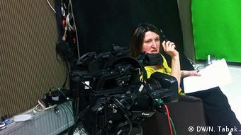 Jeta Xharra prepares for an interview at her studio in Prishtina, Kosovo. March 3, Prishtina, Kosovo. (photo: Nate Tabak)