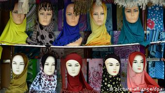 Mannequins wear head scarves in a shop in Kuah, on the island of Langkawi. (Photo: Soeren Stache)