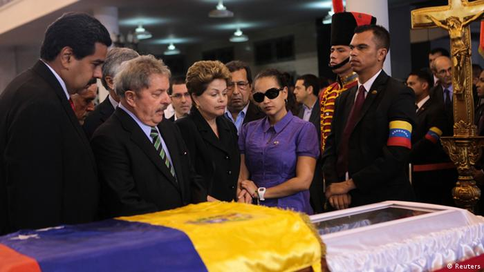 Venezuela's Vice President Nicolas Maduro (L), Brazil's former President Luiz Inacio Lula da Silva (2nd L), Brazil's President Dilma Rousseff (C) and Rosa Virginia, daughter of Venezuela's late President Hugo Chavez, view Chavez's coffin during a wake at the military academy in Caracas March 7, 2013, in this picture provided by the Miraflores Palace. Chavez will be embalmed and put on display for eternity at a military museum after a state funeral and an extended period of lying in state, acting President Nicolas Maduro said on Thursday. REUTERS/Miraflores Palace/Handout (VENEZUELA - Tags: POLITICS OBITUARY) ATTENTION EDITORS - THIS IMAGE WAS PROVIDED BY A THIRD PARTY. FOR EDITORIAL USE ONLY. NOT FOR SALE FOR MARKETING OR ADVERTISING CAMPAIGNS. THIS PICTURE IS DISTRIBUTED EXACTLY AS RECEIVED BY REUTERS, AS A SERVICE TO CLIENTS