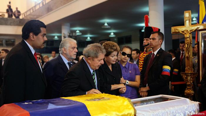 Venezuela's Vice President Nicolas Maduro (L), Brazil's former President Luiz Inacio Lula da Silva (3rd L), Brazil's President Dilma Rousseff (3rd R) and Rosa Virginia (2nd R), daughter of Venezuela's late President Hugo Chavez, view Chavez's coffin during a wake at the military academy in Caracas March 7, 2013, in this picture provided by the Miraflores Palace. Chavez will be embalmed and put on display for eternity at a military museum after a state funeral and an extended period of lying in state, acting President Nicolas Maduro said on Thursday.