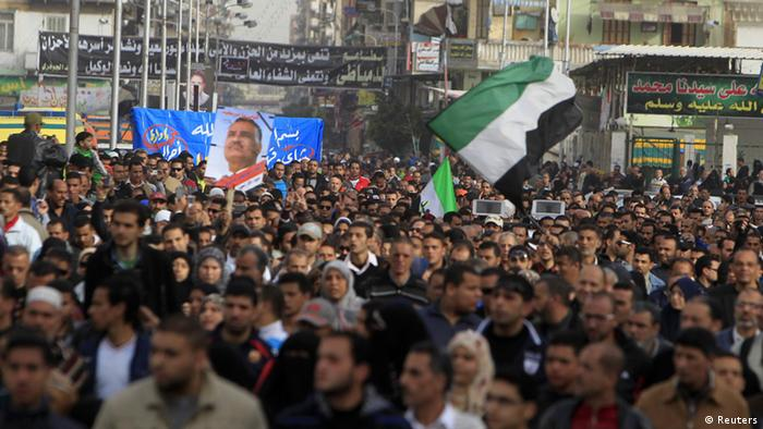 People against Egyptian President Mohamed Mursi attend the funeral of Ahmed Galal, who died during clashes between police and demonstrators, in Port Said city, 170 km (106 miles) northeast of Cairo, March 8, 2013. Port Said has been a flashpoint since January, with violent protests over death sentences given to local people in connection with a football stadium riot in which more than 70 people died last year. At least seven people have been killed in this week's protests in Port Said - three security officials and four civilians. REUTERS/Mohamed Abd El Ghany (EGYPT - Tags: POLITICS CIVIL UNREST)