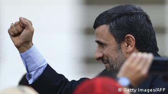 Iran's President Mahmoud Ahmadinejad raises his clenched fist in salutation during the funeral of Venezuela's President Hugo Chavez in Caracas, on March 8, 2013. Latin American leaders and US foes paid tribute to Venezuelan leader Hugo Chavez on Friday as he lay in state in a flag-draped coffin during a lavish state funeral before the nation swears-in an interim president. AFP PHOTO/JUAN BARRETO (Photo credit should read JUAN BARRETO/AFP/Getty Images)