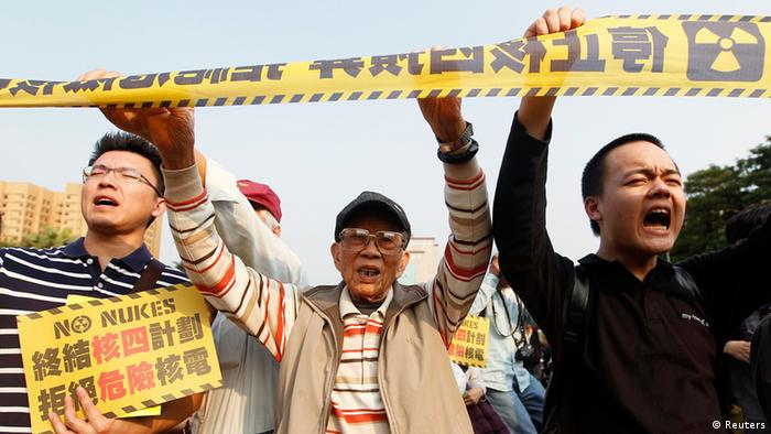 Anti-nuclear activists shout slogans during a protest in front of the Presidential Office in Taipei March 9, 2013. Tens of thousands of anti-nuclear activists around Taiwan marched the streets on Saturday to urge the government to terminate the controversial fourth nuclear power plant project and to stop using nuclear power. The Chinese characters on the placard read, To stop the fourth nuclear power plant project. Reject dangerous nuclear power. REUTERS/Pichi Chuang (TAIWAN - Tags: POLITICS ENERGY CIVIL UNREST)