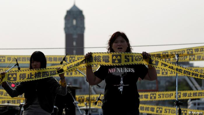 Anti-nuclear activists shout slogans during a protest in front of the Presidential Office in Taipei March 9, 2013. Tens of thousands of anti-nuclear activists around Taiwan marched the streets on Saturday to urge the Taiwanese government to terminate the controversial fourth nuclear power plant project and to stop using nuclear power. The Chinese characters read, To stop budgets on the fourth nuclear power plant project. REUTERS/Pichi Chuang (TAIWAN - Tags: POLITICS ENERGY CIVIL UNREST)