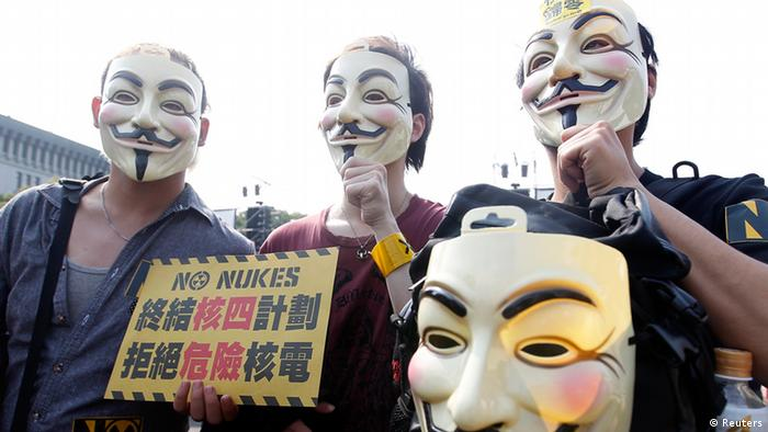 Anti-nuclear activists with Guy Fawkes masks take part in a protest in Taipei March 9, 2013. Tens of thousands of anti-nuclear activists around Taiwan marched the streets on Saturday to urge the government to terminate the controversial fourth nuclear power plant project and to stop using nuclear power. The Chinese characters on the placard read, To stop the fourth nuclear power plant project. Reject dangerous nuclear power. REUTERS/Pichi Chuang (TAIWAN - Tags: POLITICS ENERGY CIVIL UNREST)
