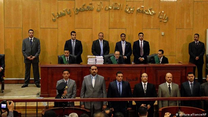 Judges of the Port Said Criminal Court, holding a hearing in Cairo for security reasons, rules in the case of last year's soccer violence in Port Said which left over 70 dead in Cairo, Egypt, Saturday, March 9, 2013. An Egyptian court has confirmed death sentences handed down against 21 people for their role in a deadly 2012 soccer riot that killed more than 70 people in the city of Port Said. (Ahmed Abd El Latef, El Shorouk Newspaper) EGYPT OUT