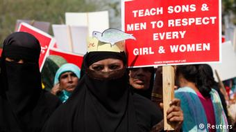 Activists hold placards as they take part in a rally to commemorate International Women's Day in Lahore