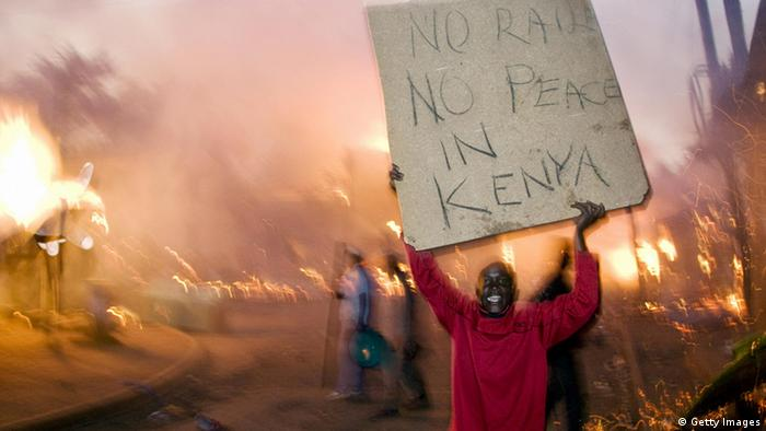 A Kenyan protester holds a poster. (Getty Images)