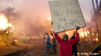 Fires burn after the disputed re-election of Mwai Kibaki as president in December 2007 (Photo:YASUYOSHI CHIBA/AFP/Getty Images)