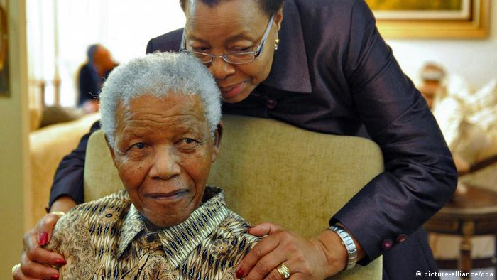 epa03122612 A file handout image dated 16 May 2011 showing former South African President Nelson Mandela (L) relaxing with his wife Graca Machel (R) at his private residence after casting his special vote for the upcoming 2011 Local Government Elections, Johannesburg, South Africa. Media reports state Nelson Mandela left a hospital 26 February 2012 after having had a diagnostic abdominal surgery the day before. South African Defence Minister Lindiwe Sisulu said the 93-year-old Nobel Prize laureate and former president was well after the procedure, which consists of inserting a tiny camera in the abdomen to inspect internal organs. EPA/ELMOND JIYANE / HANDOUT HANDOUT EDITORIAL USE ONLY *** Local Caption *** 00000402736393