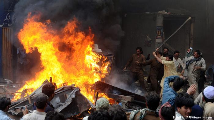 Angry Pakistani demonstraters torch Christian's belongings during a protest over a blasphemy row in a Christian neighborhood in Badami Bagh area of Lahore on March 9, 2013 (Photo: Arif Ali/AFP/Getty Images)