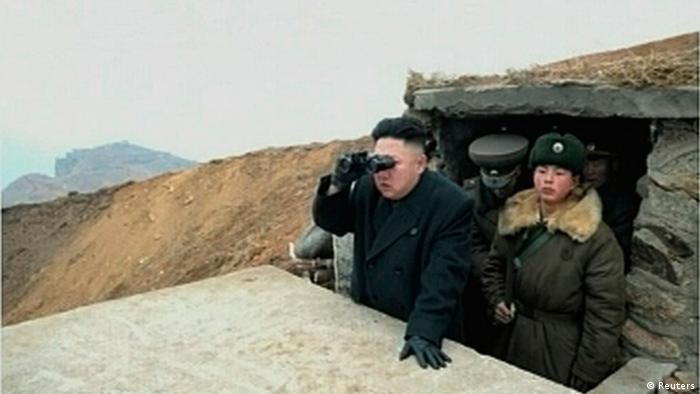 North Korean leader Kim Jong-un looks through a pair of binoculars at an undisclosed location, in this still image taken from video shown by North Korea's state-run television KRT on March 8, 2013. (Photo via Reuters)