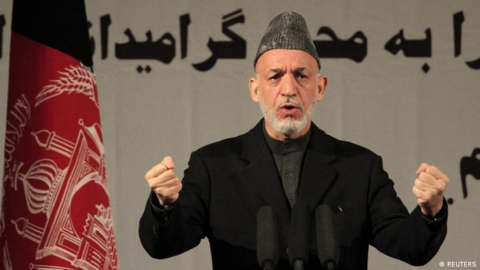 [38040779] International Women's Day epa03617540 Afghan President Hamid Karzai speaks during an event commemorating International Women's Day, in Kabul, Afghanistan, 10 March 2013. International Women's Day was marked around the world on 08 March. Afghanistan has made some progress in applying three-year-old legislation that criminalizes violence against women, but gaps in implementation remain, the United Nations said on 11 December 2012. EPA/S. SABAWOON +++(c) dpa - Bildfunk+++