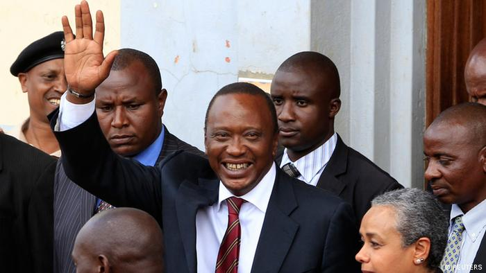 President elect Uhuru Kenyatta greets his supporters in the company of his wife Margaret soon after attending a church service in his rural home town of Gatundu, north of capital Nairobi, March 10, 2013. REUTERS/Noor Khamis (KENYA - Tags: ELECTIONS POLITICS SOCIETY)