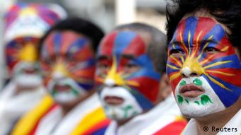 Activists with the colours of the Tibetan flag painted on their faces take part in a rally to support Tibet in Taipei March 10, 2013. Hundreds of Tibetans and their supporters in Taiwan marched the streets to commemorate the uprising in Lhasa 54 years ago against Chinese rule. REUTERS/Pichi Chuang (TAIWAN - Tags: POLITICS CIVIL UNREST ANNIVERSARY TPX IMAGES OF THE DAY)