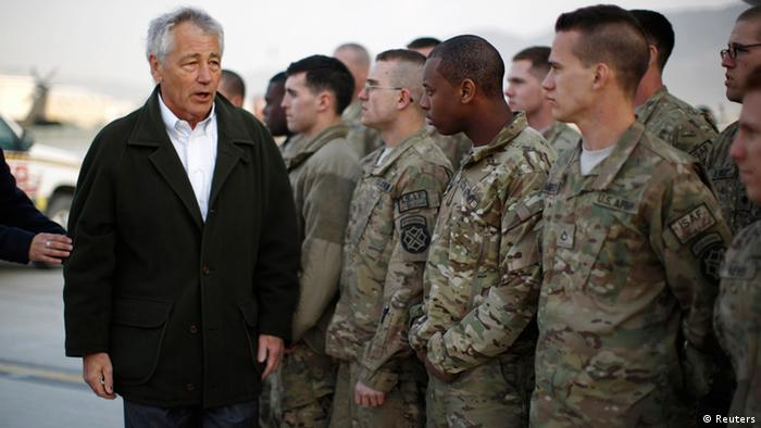 U.S. Secretary of Defense Chuck Hagel greets U.S. Army troops on the tarmac of Kabul airport, March 11, 2013 before boarding a flight to Washington. Hagel ended his three day visit to Afghanistan on Monday, his first as Secretary of Defense. REUTERS/Jason Reed (AFGHANISTAN - Tags: MILITARY POLITICS)