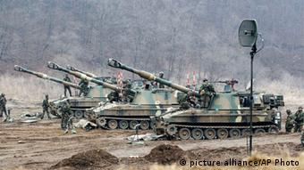 South Korean soldiers work on their K-9 self-propelled artillery vehicles AP Photo/Ahn Young-joon)