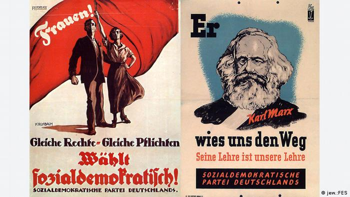 Two historical posters from Germany's first worker party, the SPD, lies side by side. In one, a man and a woman wave a red flag over the words equal rights, equal duties, vote Social Democrat! In the other, a picture of Karl Marx against a blue backdrop. The words He showed us the way. His lesson is our lesson are written above and below his portrait