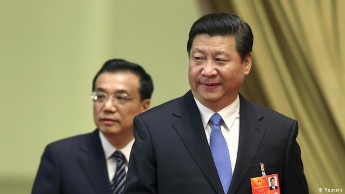 Xi Jinping (front), general secretary of the Central Committee of the Communist Party of China (CPC), and Li Keqiang, a member of the Standing Committee of the Political Bureau of the CPC Central Committee and Vice Premier, arrive at the third plenary meeting of the first session of the 12th National People's Congress (NPC) held at the Great Hall of the People in Beijing March 10, 2013. Picture taken March 10, 2013. REUTERS/China Daily (CHINA - Tags: POLITICS) CHINA OUT. NO COMMERCIAL OR EDITORIAL SALES IN CHINA