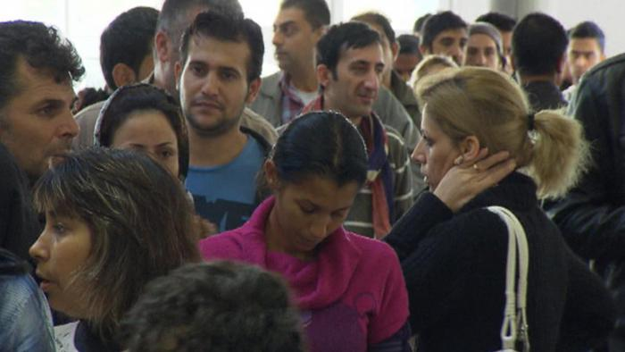 A long line of asylum seekers of various cultural backgrounds appear tired and distressed (Photo: no info)