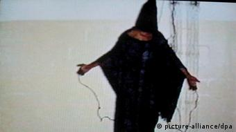 An image of an Iraqi prisoner in Abu Ghraib prison in Bhagdad allegedly standing on a box with his head covered by a hood and electrical wires attached to his hands. EPA/DSK EDITORIAL USE ONLY