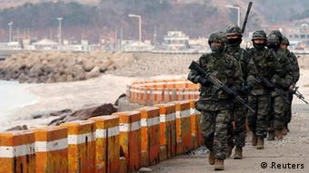 South Korean marines patrol on Yeonpyeong island near the western maritime border between the two Koreas, 11 km (7 miles) from the North, about 115 km (71 miles) northwest of Seoul March 12, 2013.