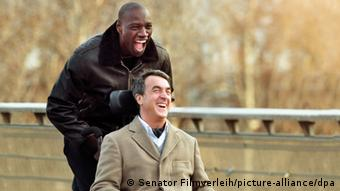 French actors Omar Sy (left) and Francois Cluzet in a scene from the film The Untouchables