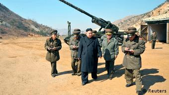 North Korean leader Kim Jong-Un (C) visits a long-range artillery sub-unit of the Korean People's Army Unit 641, whose mission is to strike Baengnyeong Island of South Korea in the western sector of the front line March 11, 2013 in this picture released by the North's official KCNA news agency in Pyongyang March 12, 2013. South Korea and U.S. forces are conducting large-scale military drills, while the North is also gearing up for a massive military exercise. North Korea has accused the U.S. of using the military drills in the South as a launch pad for a nuclear war and has said to scrap the armistice with the U.S. that ended the 1950-53 Korean War. REUTERS/KCNA (NORTH KOREA - Tags: POLITICS MILITARY CIVIL UNREST) ATTENTION EDITORS - THIS PICTURE WAS PROVIDED BY A THIRD PARTY. REUTERS IS UNABLE TO INDEPENDENTLY VERIFY THE AUTHENTICITY, CONTENT, LOCATION OR DATE OF THIS IMAGE. THIS PICTURE IS DISTRIBUTED EXACTLY AS RECEIVED BY REUTERS, AS A SERVICE TO CLIENTS. QUALITY FROM SOURCE. NO THIRD PARTY SALES. NOT FOR USE BY REUTERS THIRD PARTY DISTRIBUTORS ATTENTION EDITORS - THIS PICTURE WAS PROVIDED BY A THIRD PARTY. REUTERS IS UNABLE TO INDEPENDENTLY VERIFY THE AUTHENTICITY, CONTENT, LOCATION OR DATE OF THIS IMAGE. THIS PICTURE IS DISTRIBUTED EXACTLY AS RECEIVED BY REUTERS, AS A SERVICE TO CLIENTS. QUALITY FROM SOURCE. NO THIRD PARTY SALES. NOT FOR USE BY REUTERS THIRD PARTY DISTRIBUTORS