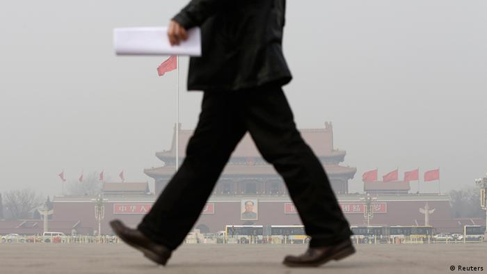 A man walks in front of Tiananmen Gate in the dust storm and haze in Beijing March 8, 2013. The 12th National People's Congress goes on till March 17th. China's new rulers will focus on consumer-led growth to narrow the gap between rich and poor while taking steps to curb pollution and graft, the government said on Tuesday, tackling the main triggers for social unrest in the giant nation. REUTERS/Jason Lee (CHINA - Tags: POLITICS ENVIRONMENT BUSINESS)