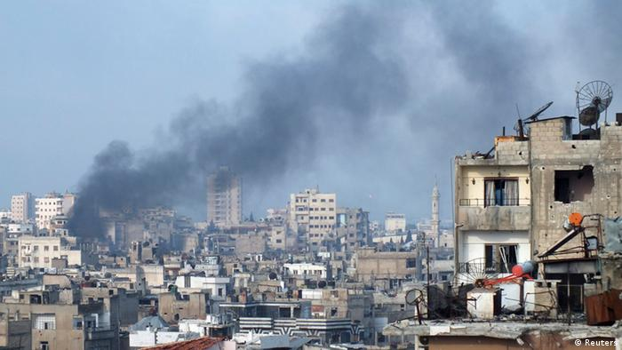 Smoke rises from one of the buildings in the city of Homs March 11, 2013. Picture taken March 11, 2013. REUTERS/Yazan Homsy (SYRIA - Tags: CONFLICT POLITICS CIVIL UNREST)
