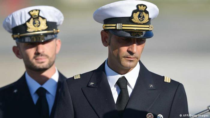 (FILES) In this photograph taken on December 22, 2012, Italian marines Massimiliano Latorre (R) and Salvatore Girone (L) arrive at Ciampino airport near Rome, on December 22, 2012. India's Supreme Court ruled February 22, 2013 that two Italian marines accused of murdering Indian fishermen while guarding an oil tanker could return home to cast their votes in upcoming national elections. The marines are suspected of shooting dead two fishermen off India's southwestern coast near the port city of Kochi in February 2012, when a fishing boat came close to the Italian oil tanker they were guarding. AFP PHOTO/ VINCENZO PINTO/ FILES (Photo credit should read VINCENZO PINTO/AFP/Getty Images)