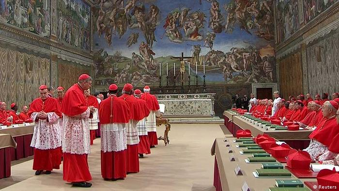 Cardinals enter the Sistine Chapel to begin the conclave in order to elect a successor to Pope Benedict, in a still image taken from video at the Vatican March 12, 2013. Shut off from the outside world, the 115 cardinals will cast their ballots in a chapel which has Michelangelo's soaring Last Judgment on one wall, and his depiction of the hand of God giving life to Adam above them. REUTERS/Vatican CTV via Reuters Tv (VATICAN - Tags: RELIGION) FOR EDITORIAL USE ONLY. NOT FOR SALE FOR MARKETING OR ADVERTISING CAMPAIGNS.