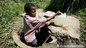 A young Zimbabwean boy getting water from a river Photo: EPA/AARON UFUMELI