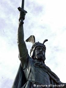 The landmark Hermann statue once again overlooks the Minnesota River town of New Ulm, Minn., Tuesday, Nov. 9, 2004. The 32-foot copper statue, which was dedicated in 1897, underwent a $1.2 million restoration. The statue depicts a Germanic warrior who led Teutonic tribes to victory over the Romans in 9 A.D., and is a symbol of this town founded by German immigrants. (AP Photo/Jim Mone)