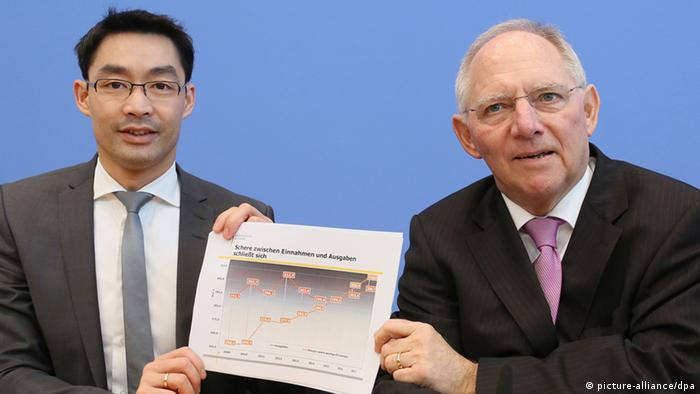 German Economics Minister Rösler and Finance Minister Schäuble presenting a draft plan in Berlin