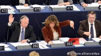 Members of the European Parliament raise their hands in a vote during the plenary session in the European Parliament in Strasbourg, France, 13 March 2013. The European Parliament rejected the compromise of EU governments for the financial planning of the European Union until 2020. EPA/PATRICK SEEGER