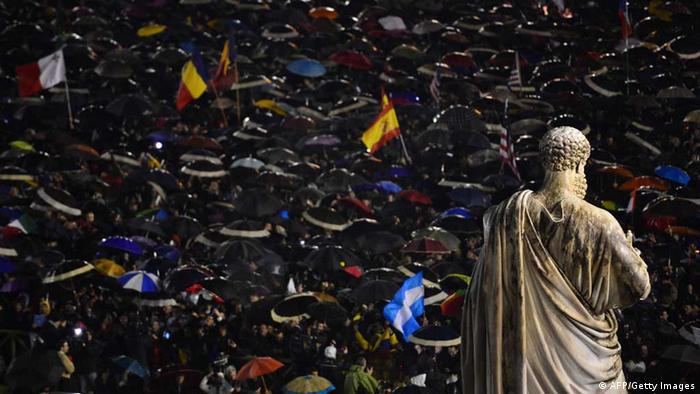 Faithfuls celebrate in St. Peter's Square under umbrellas after white smoke announced that Catholic Church cardinals had elected a new pope. (Photo: GIUSEPPE CACACE/ AFP/Getty Images)