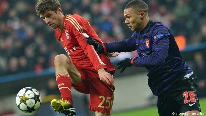 Thomas Müller and Kieran Gibbs during Champions League Bayern Muenchen - Arsenal London 2013