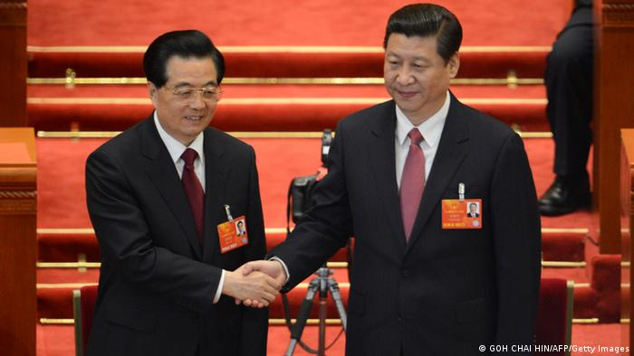 Newly-elected Chinese President Xi Jinping hold hands with former president Hu Jintao after the election of the new president of China during the12th National People's Congress (NPC) in the Great Hall of the People in Beijing on March 14, 2013. Chinese Communist Party leader Xi Jinping was named president of the world's most populous country after a vote at its parliamentary meeting in Beijing. AFP PHOTO /GOH CHAI HIN (Photo credit should read GOH CHAI HIN/AFP/Getty Images)